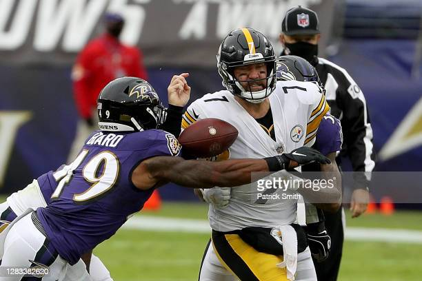 Linebacker Chris Board of the Baltimore Ravens knocks the ball out of the hands of quarterback Ben Roethlisberger of the Pittsburgh Steelers in the...