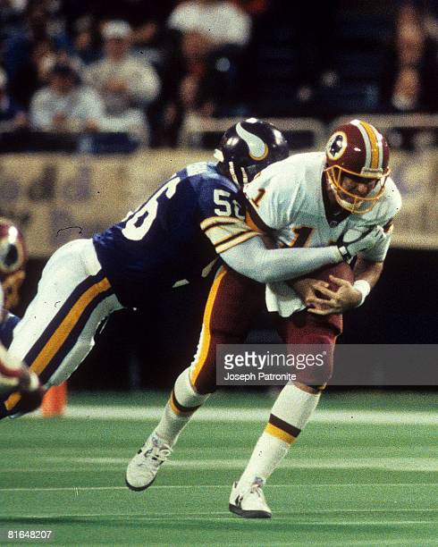 Linebacker Chris Doleman of the Minnesota Vikings sacks quarterback Mark Rypien of the Washington Redskins in the 1992 NFC Wildcard Game at the...