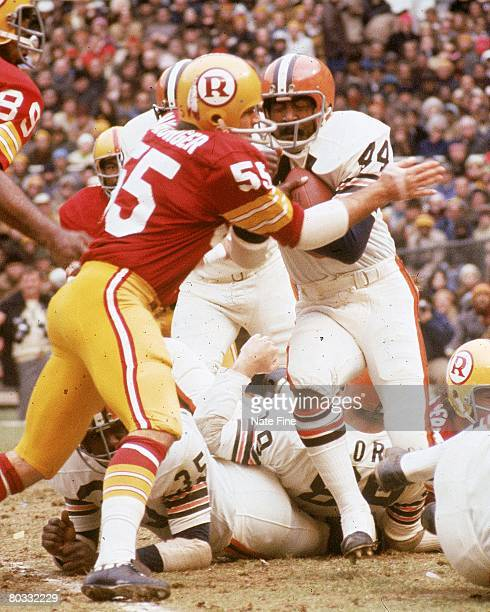 C DECEMBER 19 Linebacker Chris Hanburger of the Washington Redskins stops running back Leroy Kelly of the Cleveland Browns during an NFL game at RFK...