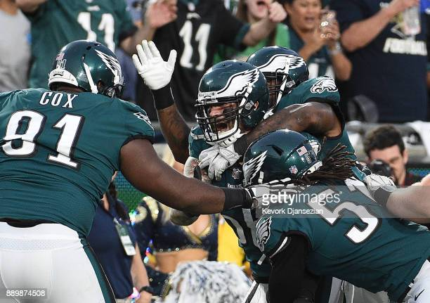 Linebacker Chris Long of the Philadelphia Eagles is mobbed by his teammates after stripping the ball from Jared Goff of the Los Angeles Rams at Los...