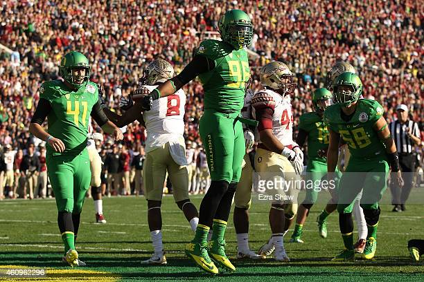 Linebacker Christian French of the Oregon Ducks celebrates after scoring a twopoint conversion against the Florida State Seminoles during the College...