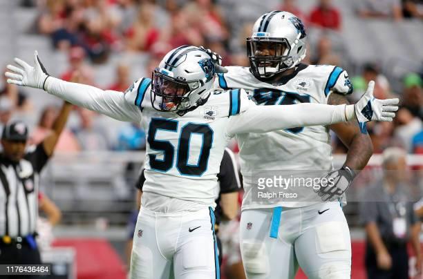 Linebacker Christian Miller of the Carolina Panthers celebrates with teammate Dontari Poe after a sack of quarterback Kyler Murray of the Arizona...