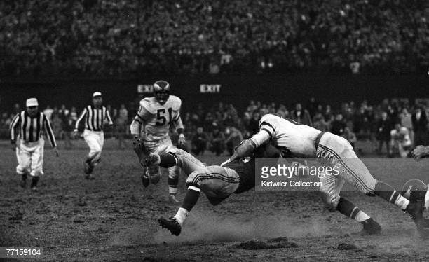 Linebacker Chuck Bednarik of the Philadelphia Eagles hits Frank Gifford of the New York Giants to stop the last chance the Giants had of coming back...