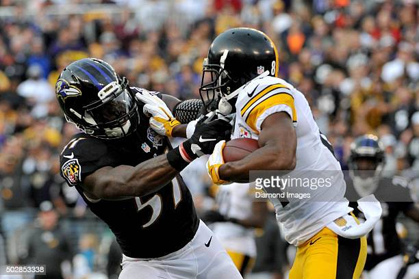 Linebacker CJ Mosley of the Baltimore Ravens fights off the stiff arm of wide receiver Antonio Brown of the Pittsburgh Steelers during a game on...