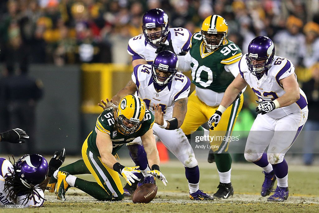 Linebacker Clay Matthews #52 of the Green Bay Packers recovers a forced fumble in front of quarterback Joe Webb #14 of the Minnesota Vikings in the second half during the NFC Wild Card Playoff game at Lambeau Field on January 5, 2013 in Green Bay, Wisconsin.