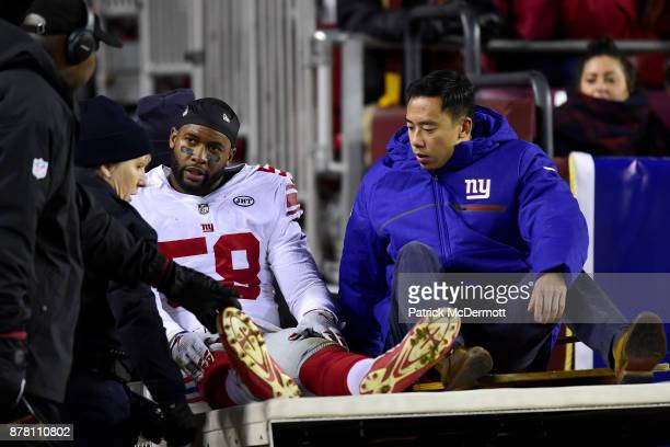 Linebacker Curtis Grant of the New York Giants is carted off the field after getting hurt in the first quarter against the Washington Redskins at...
