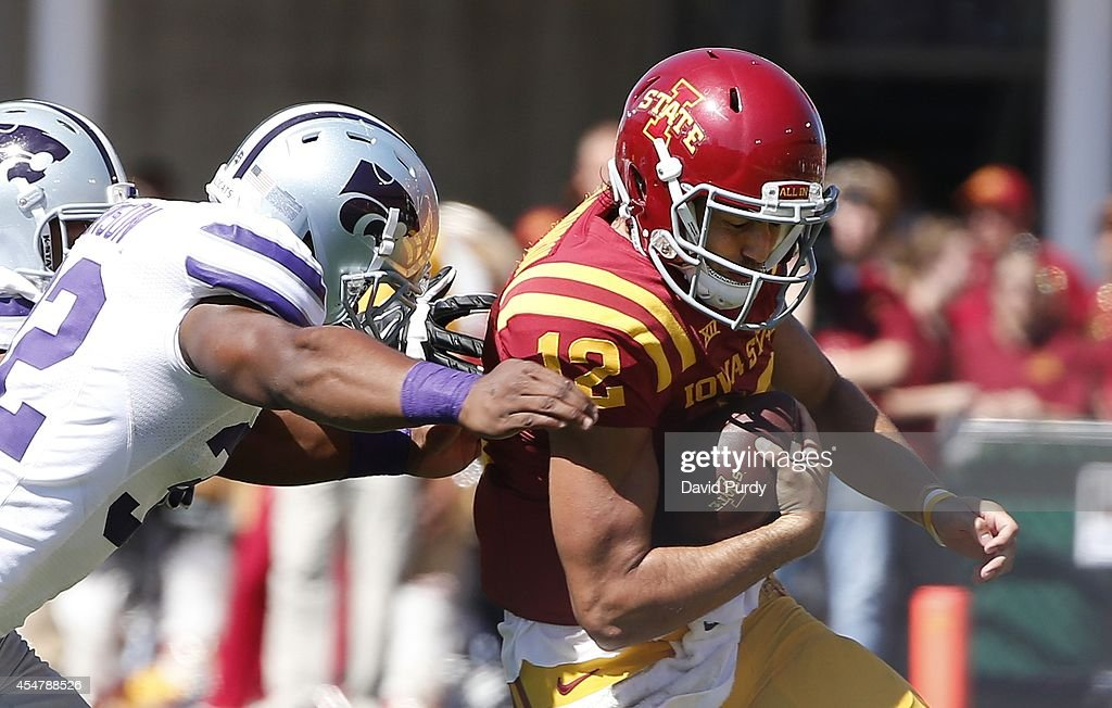 Linebacker Dakorey Johnson #32 of the Kansas State Wildcats tackles quarterback Sam B. Richardson #12 of the Iowa State Cyclones in the second half of play at Jack Trice Stadium on September 6, 2014 in Ames, Iowa. Kansas State won 32-28 over the Iowa State Cyclones.