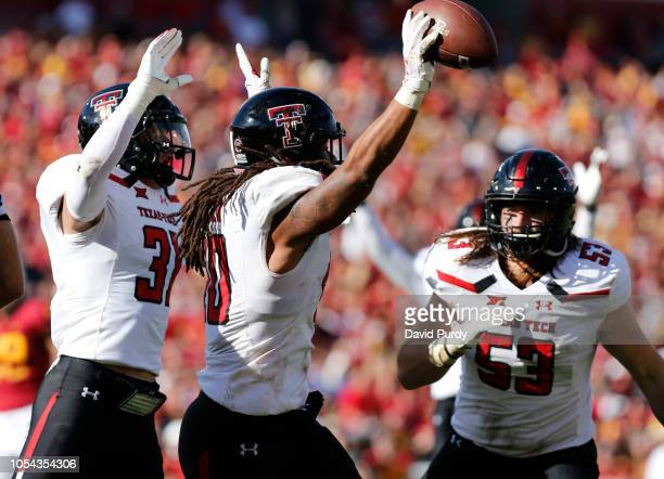 Linebacker Dakota Allen of the Texas Tech Red Raiders celebrates with teammates defensive back Justus Parker and defensive lineman Eli Howard of the...