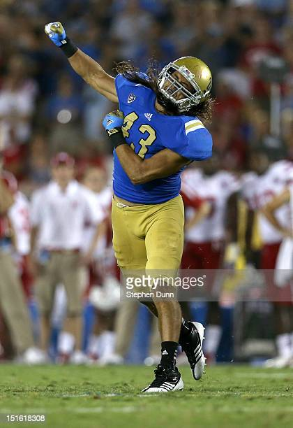 Linebacker Damien Holmes of the UCLA Bruins celebrates after tackling quarterback Taylor Martinez of the Nebraska Cornhuskers at the Rose Bowl on...
