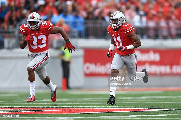 Linebacker Dante Booker and safety Vonn Bell of the Ohio State Buckeyes against the Northern Illinois Huskies at Ohio Stadium on September 19 2015 in...