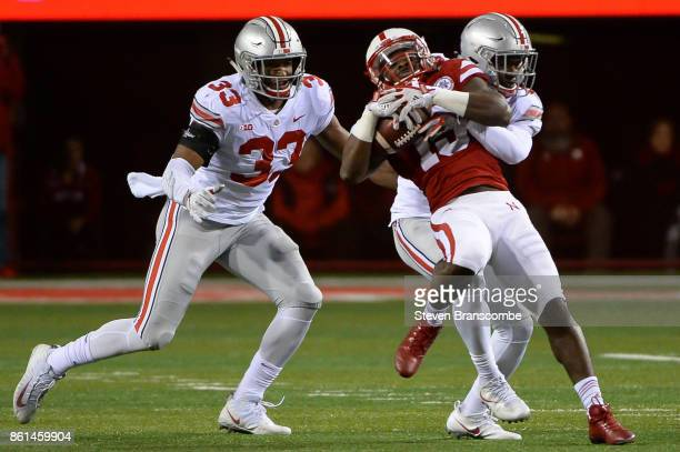 Linebacker Dante Booker of the Ohio State Buckeyes and cornerback Kendall Sheffield tackle wide receiver De'Mornay PiersonEl of the Nebraska...