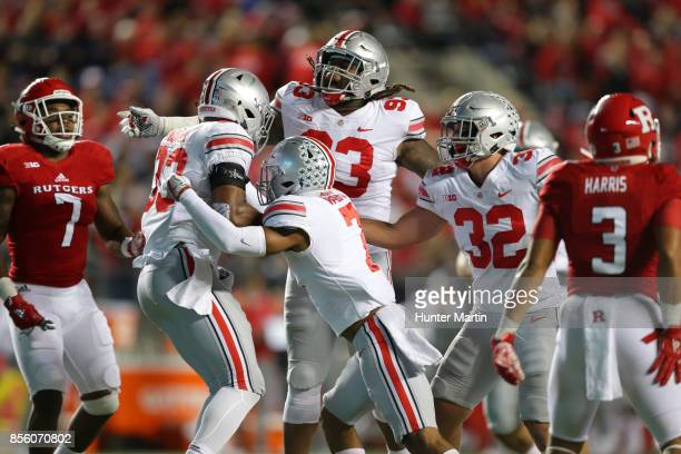 Linebacker Dante Booker of the Ohio State Buckeyes celebrates with teammates after intercepting a pass during a game against the Rutgers Scarlet...