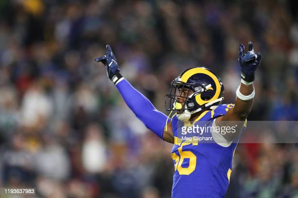 Linebacker Dante Fowler of the Los Angeles Rams amps up the crowd during the game against the Seattle Seahawks at Los Angeles Memorial Coliseum on...