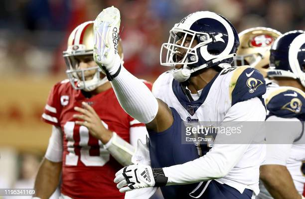 Linebacker Dante Fowler of the Los Angeles Rams celebrates after sacking quarterback Jimmy Garoppolo of the San Francisco 49ers during the game at...