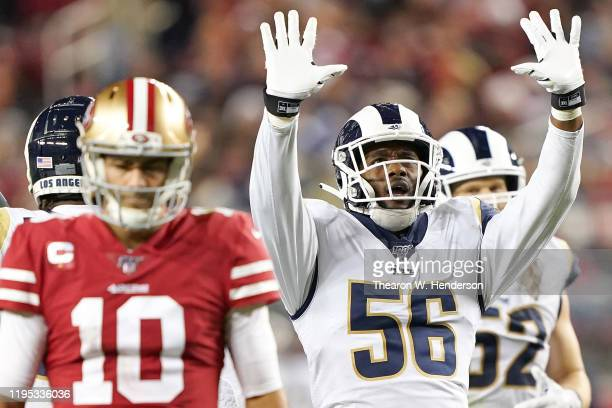Linebacker Dante Fowler of the Los Angeles Rams celebrates sacking quarterback Jimmy Garoppolo of the San Francisco 49ers during the game at Levi's...