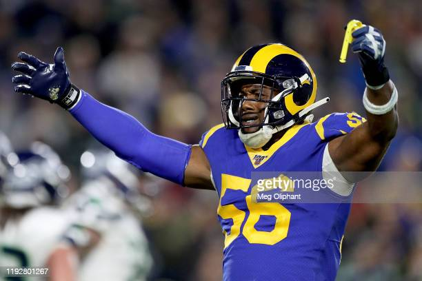 Linebacker Dante Fowler of the Los Angeles Rams gestures to the crowd during the game against the Seattle Seahawks at Los Angeles Memorial Coliseum...