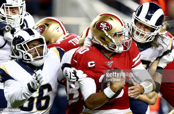 Linebacker Dante Fowler of the Los Angeles Rams sacks quarterback Jimmy Garoppolo of the San Francisco 49ers during the game at Levi's Stadium on...