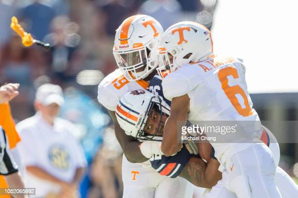 Linebacker Darrell Taylor of the Tennessee Volunteers and defensive back Alontae Taylor of the Tennessee Volunteers tackle running back Malik Miller...