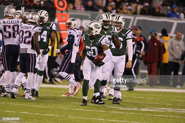 Linebacker Darron Lee of the New York Jets picks up a loose ball against the New England Patriots on November 27 2016 at MetLife Stadium in East...