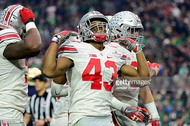 Linebacker Darron Lee of the Ohio State Buckeyes celebrates during the fourth quarter of the BattleFrog Fiesta Bowl against the Notre Dame Fighting...