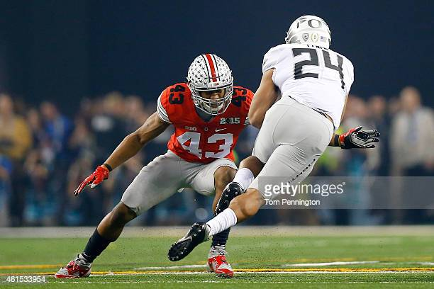 Linebacker Darron Lee of the Ohio State Buckeyes looks to tackle running back Thomas Tyner of the Oregon Ducks during the College Football Playoff...