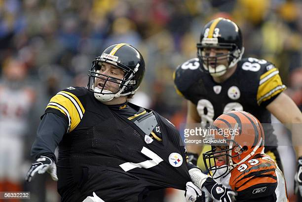 Linebacker David Pollack of the Cincinnati Bengals pulls the jersey of quarterback Ben Roethlisberger of the Pittsburgh Steelers at Heinz Field on...