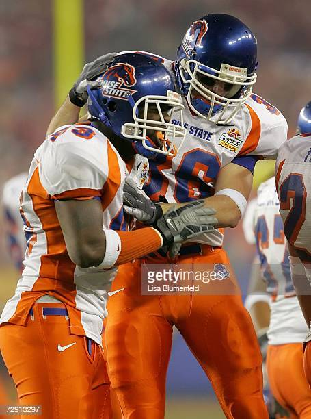 Linebacker David Shields and defensive back Seth Anderson of the Boise State Broncos celebrate a play against the Oklahoma Sooners at the Tostito's...