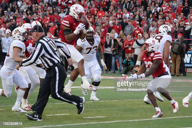 Linebacker Dedrick Young II of the Nebraska Cornhuskers intercepts a pass against the Minnesota Golden Gophers in the second half at Memorial Stadium...