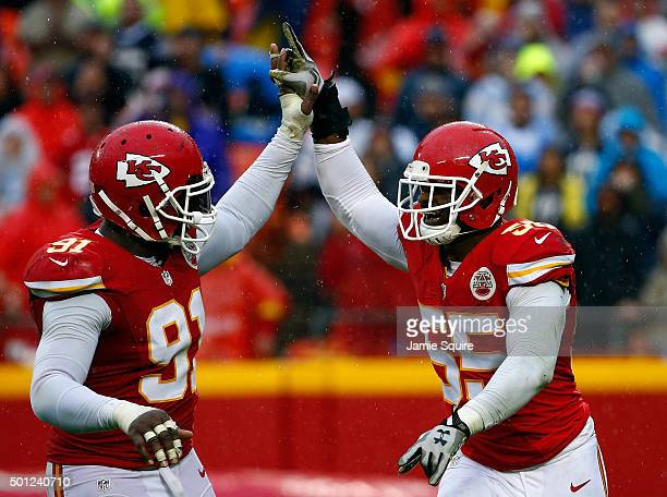 Linebacker Dee Ford of the Kansas City Chiefs is congratulated by outside linebacker Tamba Hali after making a sack during the game against the San...