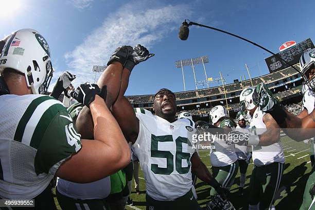 Linebacker Demario Davis of the New York Jets fires up his teammates against the Oakland Raiders at Oco Coliseum on November 1 2015 in Oakland...