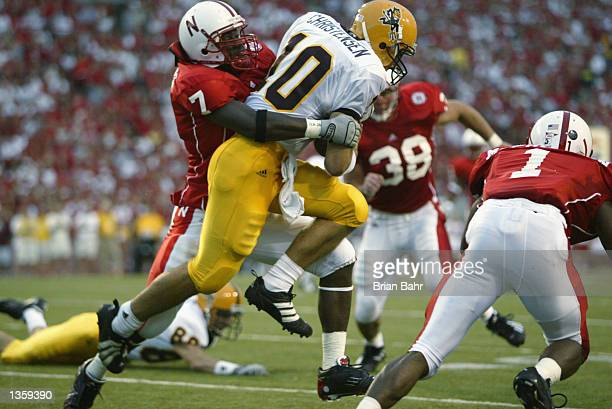 Linebacker Demorrio Williams of the Nebraska Cornhuskers tackles quarterback Chad Christensen of the Arizona State Sun Devils during the NCAA...