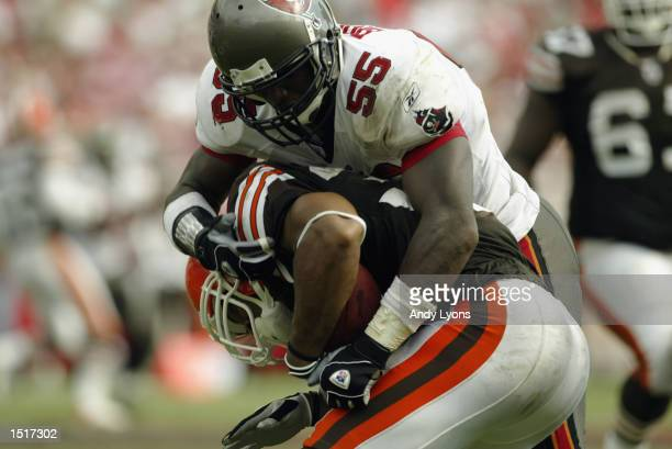 Linebacker Derrick Brooks of the Tampa Bay Buccaneers tackles running back Jamel White of the Cleveland Browns during the NFL game on October 13 2002...