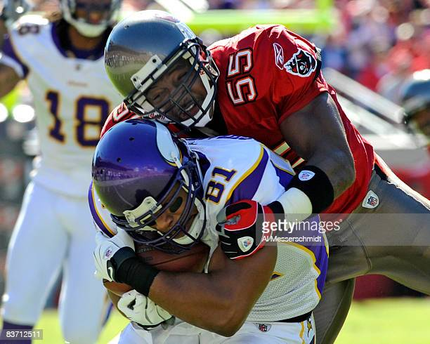 Linebacker Derrick Brooks of the Tampa Bay Buccaneers tackles wide receiver Visanthe Shiancoe of the Minnesota Vikings at Raymond James Stadium on...