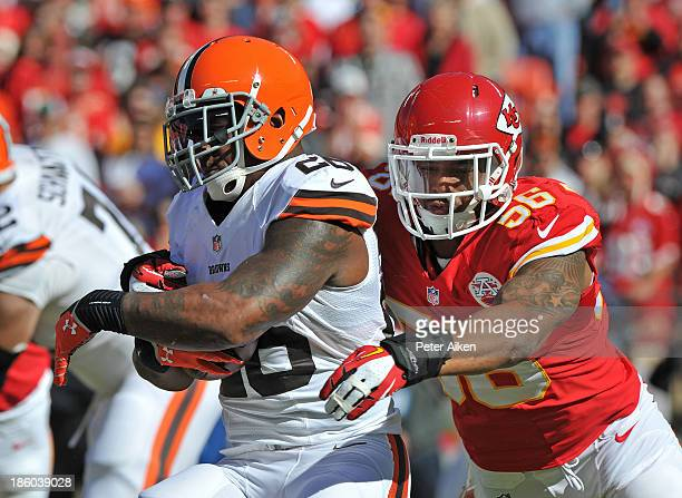 Linebacker Derrick Johnson of the Kansas City Chiefs tackles running back Willis McGahee of the Cleveland Browns for a loss during the first half on...