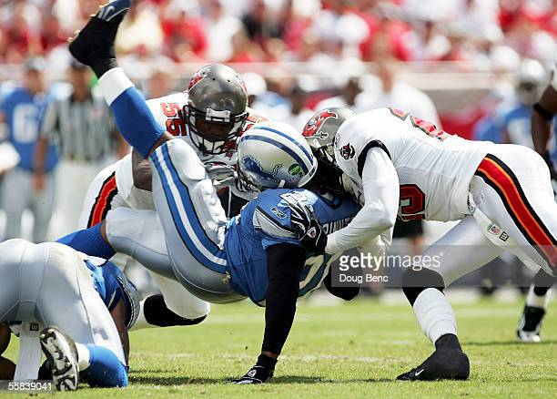 Linebacker Derrrick Brooks and safety Jermaine Phillips of the Tampa Bay Buccaneers collide to hit running back Artose Pinner of the Detroit Lions on...