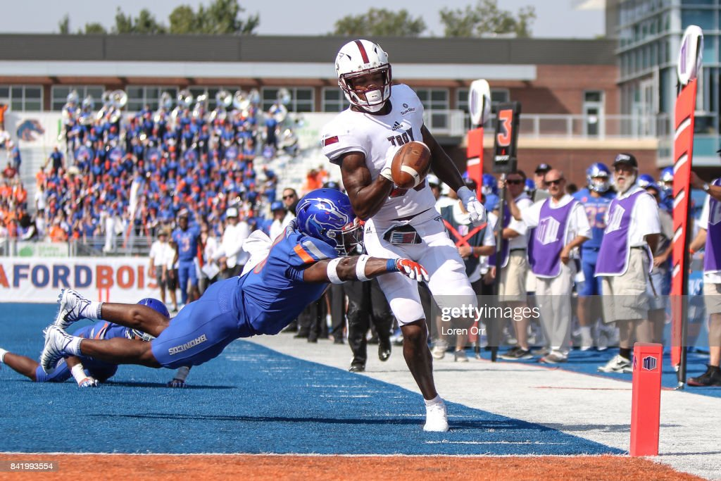 Linebacker Desmond Williams #9 of the Boise State Broncos knocks the ball out of wide receiver Deondre Douglas #80 of the Troy Trojans hands just before the goal line during second half action on September 2, 2017 at Albertsons Stadium in Boise, Idaho. Boise State won the game 24-13.
