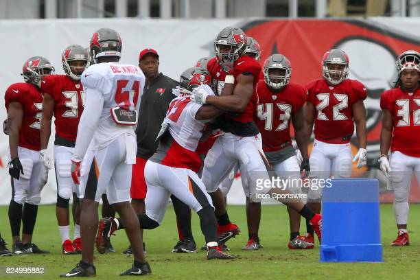 Linebacker Devante Bond goes against tight end O. J. Howard in drills during the Tampa Bay Buccaneers Training Camp on July 31, 2017 at One Buccaneer...