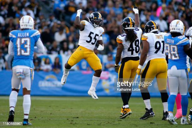 Linebacker Devin Bush and outside linebacker Bud Dupree of the Pittsburgh Steelers celebrate a down during the first quarter against the Los Angeles...