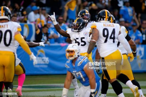 Linebacker Devin Bush of the Pittsburgh Steelers and free safety Minkah Fitzpatrick of the Pittsburgh Steelers celebrate a touchdown during the first...