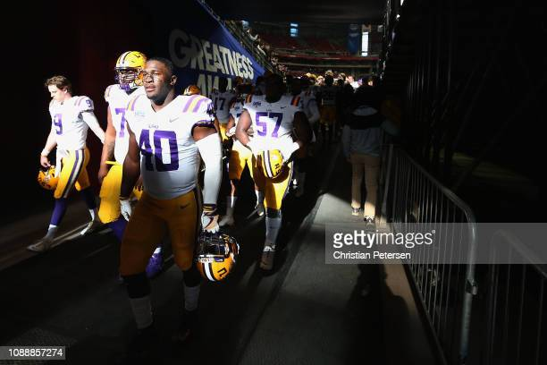 Linebacker Devin White of the LSU Tigers walks off the field before the PlayStation Fiesta Bowl against the UCF Knights at State Farm Stadium on...