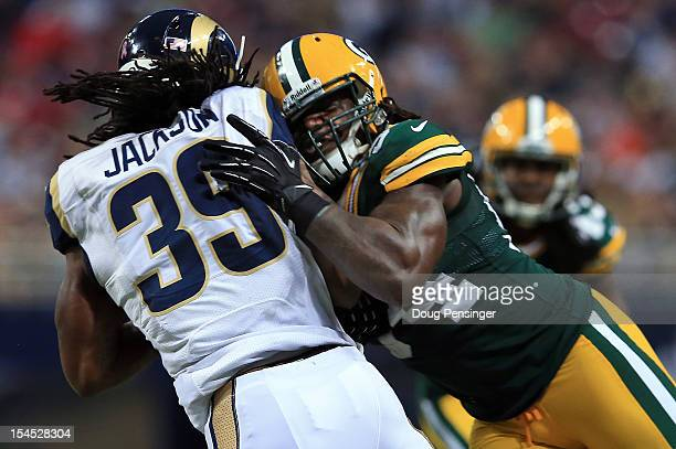 Linebacker Dezman Moses of the Green Bay Packers hits running back Steven Jackson of the St Louis Rams on an incomplete pass play in the third...