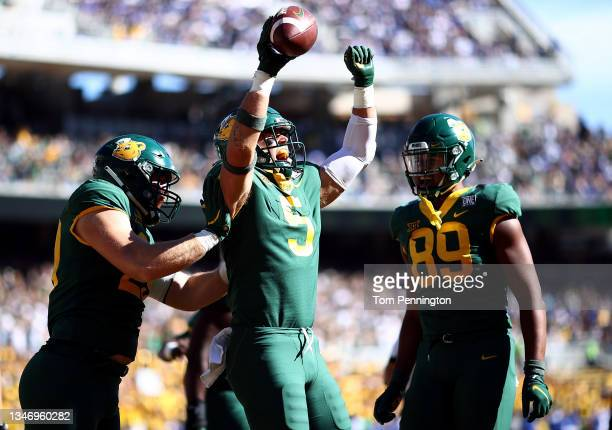 Linebacker Dillon Doyle of the Baylor Bears celebrates after scoring a touchdown against the Brigham Young Cougars in the first half at McLane...