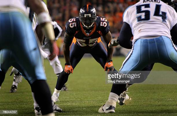 Linebacker DJ Williams of the Denver Broncos faces off against the Tennessee Titans at Invesco Field at Mile High on November 19 2007 in Denver...