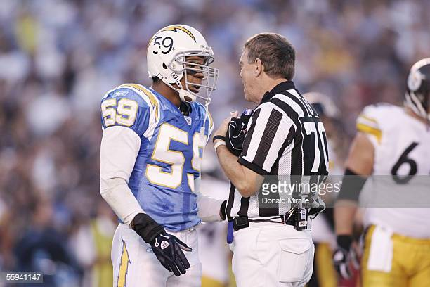 Linebacker Donnie Edwards of the San Diego Chargers talks to umpire Scott Dawson against the Pittsburgh Steelers at Qualcomm Stadium on October 10...