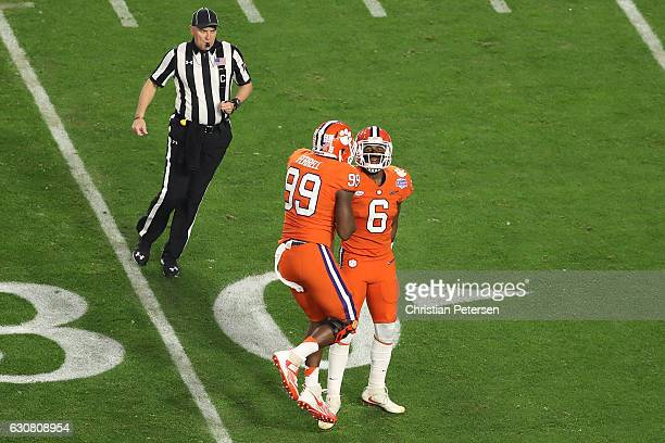 Linebacker Dorian O'Daniel of the Clemson Tigers is congratulated by defensive end Clelin Ferrell after a stop against Ohio State Buckeyes during the...