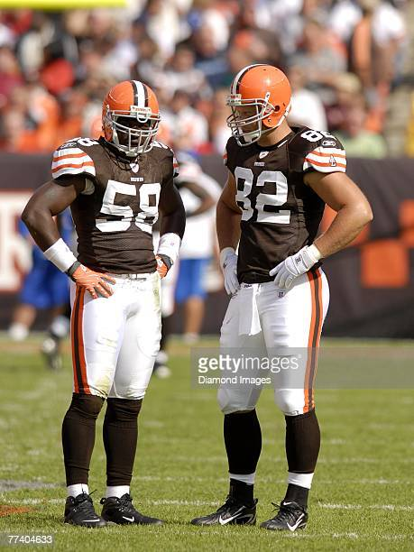 Linebacker D'Qwell Jackson and tight end Steve Heiden of the Cleveland Browns discuss the next play prior to a kickoff during a game with the Miami...
