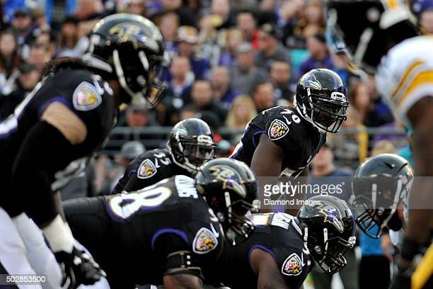 Linebacker Elvis Dumervil of the Baltimore Ravens awaits the snap at the line of scrimmage during a game against the Pittsburgh Steelers on December...