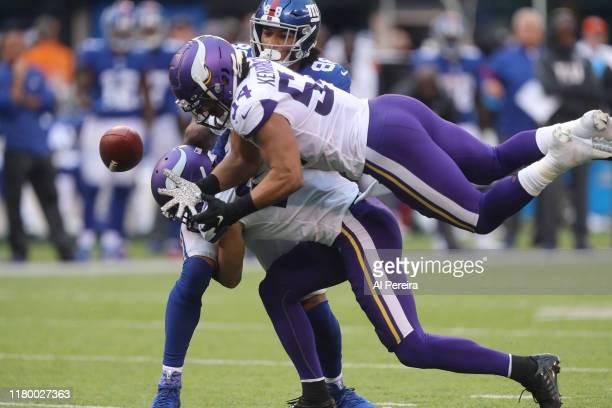 Linebacker Eric Kendricks of the Minnesota Vikings misses an interception after Safety Harrison Smith of the Minnesota Vikings breaks up a pass...