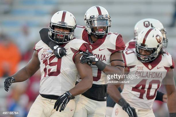 Linebacker Eric Striker and Safety Steven Parker of the Oklahoma Sooners celebrate a turnover during their win against the Kansas Jayhawks on October...