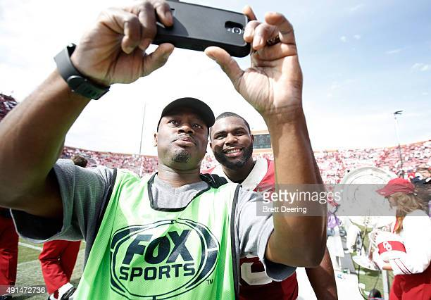 Linebacker Eric Striker of the Oklahoma Sooners takes a 'selfie' with a fan after the game against the West Virginia Mountaineers October 3 2015 at...